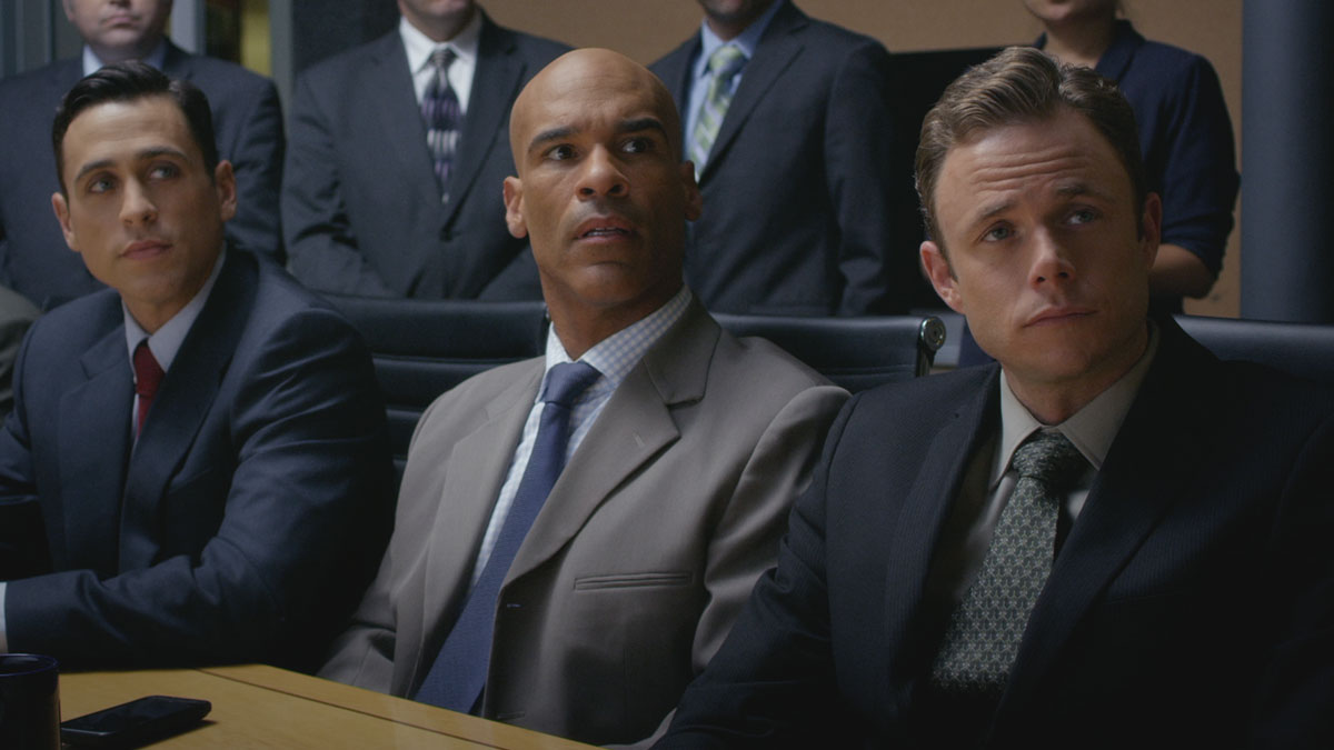 Michael Klinger, Darren Dupree Washington and Bradley Snedeker in an office scene.